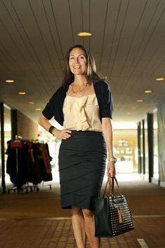 As the buyer and manager of Jones & Jones in Cross Keys, Karen Ciurca-Weiner has access to some of the region's best designers and labels.  Her Marc Cain short-sleeve cardigan was perfectly draped over her ruffled blush-colored blouse by Trina Turk. Both items were purchased at her boutique. Her gold studded black leather purse by High Fashion handbags was also from Jones & Jones, as was her Page Jewelry bracelet. Her open toe platform pumps were by Stuart Weitzman at Nordstrom.