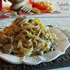 Tagliatelle funghi panna e salsiccia