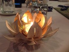 Gilded Lotus Votive Holder Is a symbol of fortune and enlightenment.  It grows in muddy water, and when starts to flower the buds rise and bloom above the murk to achieve enlightenment.  What a lovely way to say I care, I love you, thank you and congratulations!