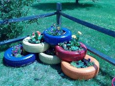 My brightly painted, recycled tire garden:-) :-) :-) I was inspired by several pins that I gleaned bits and pieces from Tire Garden, Garden Yard Ideas, Raised Garden Beds, Lawn And Garden, Garden Projects, Tire Craft, Tyres Recycle, Recycled Tires, Ponds Backyard
