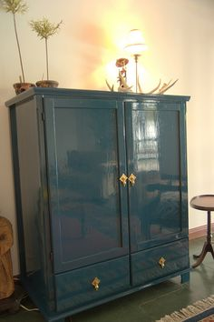 love this color! i have a black cabinet like this that could use a new look. hmm..