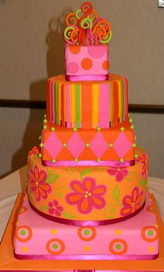 Bright whimsical wedding cake in fondant by The White Flower Cake Shoppe