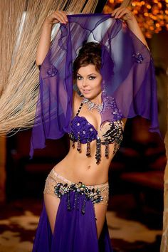 Bellydancer Leila. This kind of skirt is very sexy, with the hips so exposed and just the loin covered....