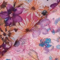 A fantastic fabric at a fantastic price! This poly-cotton print features a small vintage floral print on one side (very Liberty of London-ish) and a large vintage flower print on the other side. You'll be hard-pressed to choose a side, so use them both in your garment, either as accent pieces or on a larger scale,such as sleeves or bodice. Semi-sheer like voile with a soft hand and drape. Feels like cotton. Primarily dusty rose, with bits of purple, teal, aqua, gold and olive.