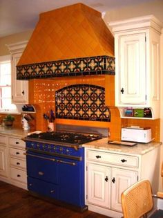 Blue stove and orange tiles [ MexicanConnexionForTile.com ] #Hacienda #kitchen #Talavera #handmade