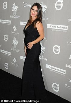 Chic and simple: The former Sabrina the Teenage Witch star wore a black, plunging neckline...