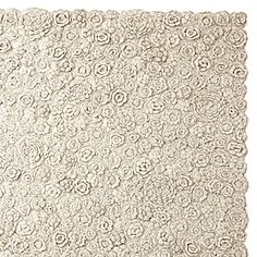Natural Flora Crocheted Rug  Delicate but durable, this pretty rug reminds us of a vintage hand-knit sweater. The texture created by the all-over crocheted pattern is dense and cozy, bringing warmth and personality to the room.
