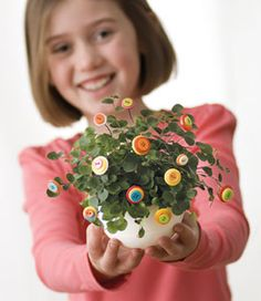 Make any green plant bloom with these cute flowers made with buttons and florist wire.