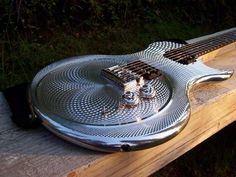 metal carved full bodied custom guitar