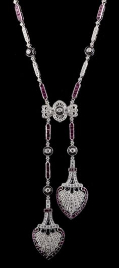 Deco Ruby, Diamond, Onyx Necklace,  features 97 Square cut  Rubies for an approximate weight of 4.55cts with 335 round diamonds for an  approximate weight of 2.99cts.  Necklace is 16″ long plus the pendant drop of 3.5″.