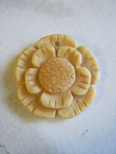 Sunflower Pendant carved bone by janissupplies on Etsy, $9.50