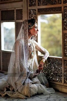 I just love this photo, not only the brides dress but the the location. A princess waiting for his prince to come and take her with her....
