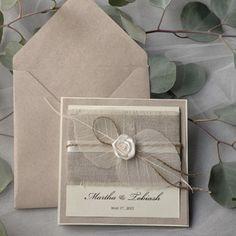 wedding invitation ... kraft ... linen cloth panel ... arrangement of skeleton leaves and satin ribbon rolled rose ... lovely ...
