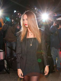 Star Tracks: Thursday, January 22, 2015 | FLASHING LIGHTS | Nothing fazes this girl! Supermodel Cara Delevingne struts her stuff at the YSL Loves Your Lips Party on Tuesday in London.