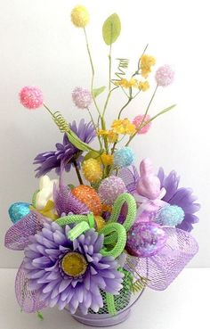 Easy spring or Easter arrangement ,your local dollar store can inspire you with materials.