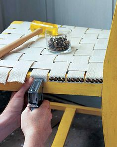 Weave a chair seat with webbing, secure with staples, cover with upholstery nails.