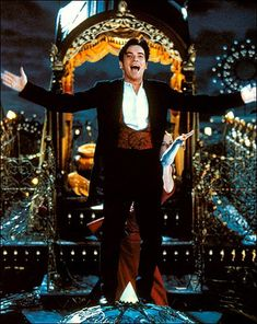 Christian (Ewan McGregor) singing on top of the elephant in Moulin Rouge