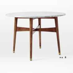 new and noteworthy / west elm marble top dining table
