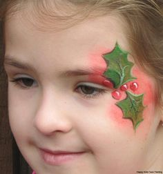 Simple holly Christmas face paint idea for eye area.