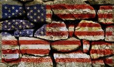 American flag painted on stone wall.