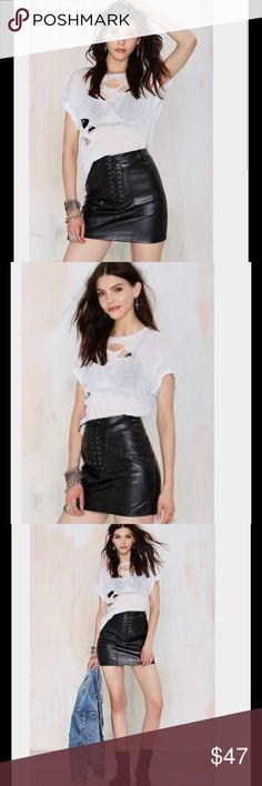 nasty gal 140 If love is a battlefield, consider this your Battle Scar. This black vegan leather skirt features panel design, lattice design at front, and top stitching detail. Back zip closure, fully lined, enclosed seams. Team it up with the Battle Scar Crop Top, or a rocker tee and combat boots. Fight the good (lookin') fight. By Nasty Gal. Skirts Mini