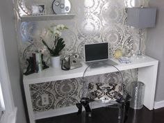 Love the wallpape.r.  Nice little nook.  Maybe as a makeup table