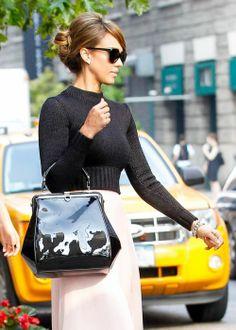 Flattering sweater, pastel skirt and bun on Jessica Alba