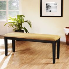 Complete your dining room decor with this unique microfiber bench. This bench is made from rubber wood and includes a microfiber cushion.