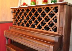 Repurposed piano into a wine rack