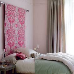 Idea: Fabric or wallpaper draped over a dowel for a  headboard
