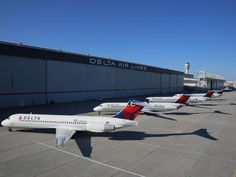 A Delta 717 [front] sits among other Delta aircraft. The others, from front to back, are a DC-9, MD-88 and MD-90. Photo: Delta Airlines