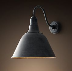 RH's Vintage French Farmhouse Sconce:The graceful yet hardworking design of an antique French farmhouse fixture is echoed in this sconce. A bell-shaped metal shade focuses the light it casts, and weathered-metal fittings capture the patina of the original.