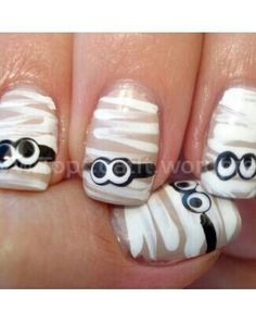 Very simple and easy to do Halloween nail art. Really cute for little kids