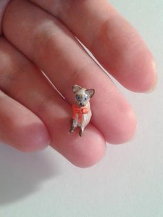 Miniature cat figurine with the red bow  Micro by Ilovemicro