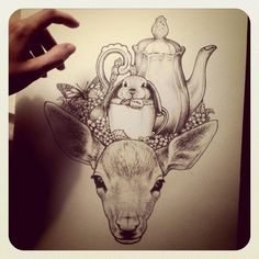 deer and a bunny in a tea cup