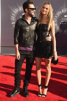 Adam Levine and Behati Prinsloo The newly married couple wore matching black leather outfits for their first red carpet appearance since getting hitched last month. Maybe it was meant to be sweet?