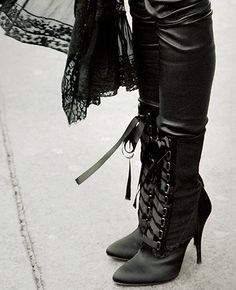Victorian lace-up boots and leather pants.