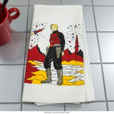Rocket Man Flour Sack Dish Towel   Vintage Kitchen Towels   RetroPlanet.com For beauty, softness and durability in the kitchen, there's nothing quite like pure cotton for all your linens. This Rocket Man Flour Sack Kitchen Towel features a vintage sci-fi motif, screen printed for colorfast longevity on a 100% cotton dish towel. Great as a housewarming or mother's day gift, this gorgeous item will add decorative distinction to any kitchen for years to come!