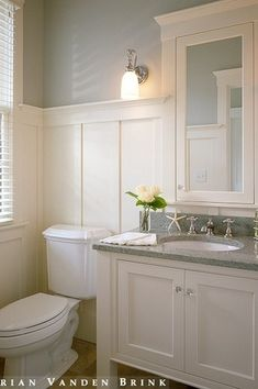 A powder room is just a rather more fancy way of referring to a bathroom or toilet room. Just like in the case of a regular bathroom, the powder room may present different challenges related to its interior design and… Continue Reading → Bathroom Renos, Bathroom Makeover, Wainscoting Bathroom, Downstairs Bathroom, Bathrooms Remodel, Bathroom Design, Bathroom Decor, Beautiful Bathrooms, Bathroom Redo