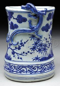 """PORCELAIN BRUSH POT. 20th century, China. Molded as a section of bamboo with pine and prunus in underglaze blue. SIZE: 7-1/2"""" h x 6"""" dia."""