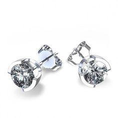 OLGA, pendientes de diamantes en medio bisel Pendientes de diamantes fabricados en oro de primera ley de 18 quilates en tipo dormilona. Los diamantes aparecen engastados en una moderna montura que agarra el diamante en medio bisel aportando un toque de distinción a esta joya para llevar a diario.