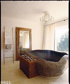 Natural granite bathtub and chandelier shower head!