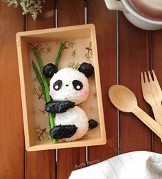 Pansy bear onigiri bento. Panda made from rice and nori, and bamboo made from asparagus.