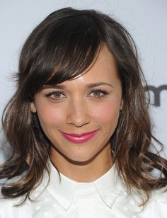 Easy and breezy is how we'd describe Rashida Jones' chic, wavy bob with side-swept bangs.