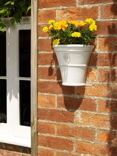 A white glazed terracotta wall pot designed by the RHS and manufactured by Apta pottery 'looking good' Outdoor Pots, Garden Supplies, Garden Pots, Container Gardening, Terracotta, Garden Design, Planter Pots, Pottery, Wall