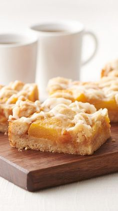 Brown Butter Peach Crumble Bars - These delicious peach crumble cookie bars are even better topped with a scoop of ice cream.