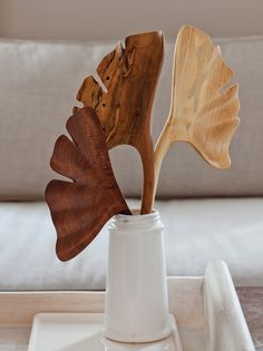 """I like this design. Woodworking wizard Dicky Stone carved this sculptural bouquet of ginkgo leaves from indigenous """"found"""" trees across the Southeast."""
