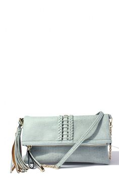 This sassy clutch is the ultimate statement accessory for your wardrobe this year. A trendy textured material, braided accent, and tassel detail for a bag with just the right amount of style and class. With an attachable shoulder strap included, this bag is perfect for a night on the town or a quick trip to the store.