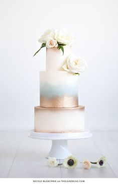 10 Wintry White Cakes | including this gold watercolor design by Nicole McEachnie | on TheCakeBlog.com