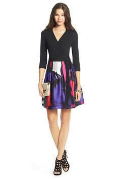 The Jewel dress is a modern wrap style featuring a full silk mikado skirt with subtle pleats. In the boldest prints of the season, it pairs perfectly with heels for a playful after dark look. True wrap style with 3/4 sleeves and pockets. Falls to above the knee. Fit is true to size.